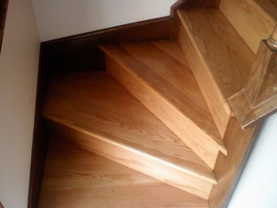Rebuilt and refinished red oak winder stairs