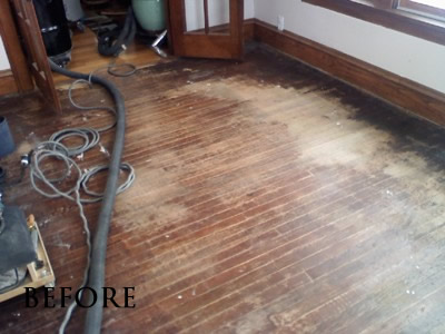 Water-damaged and stained red oak floor