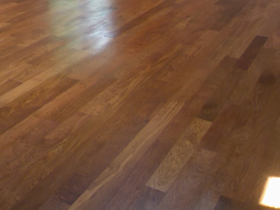New install of wide-width Brazilian Cherry (Jatoba) hardwood floor in Coralville