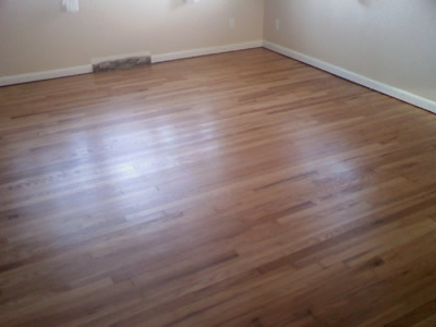 Removed carpet and glued-down parquet to refinish this original red oak hardwood floor in Iowa City