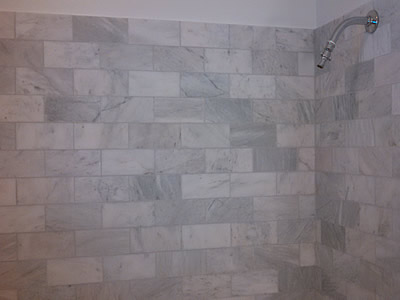 Carrera marble tile walls